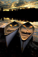 Two canoes side by side at sunrise